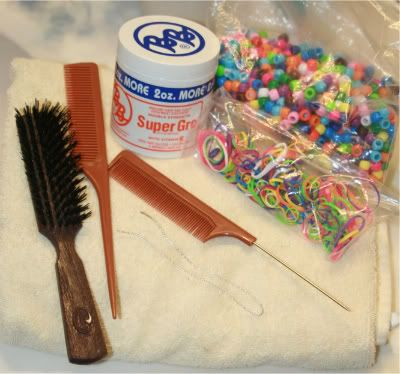 a way to put on hair beads a wire from the craft store rubber band that don't suppose to put the hair  a brush and a tail comb and super gro