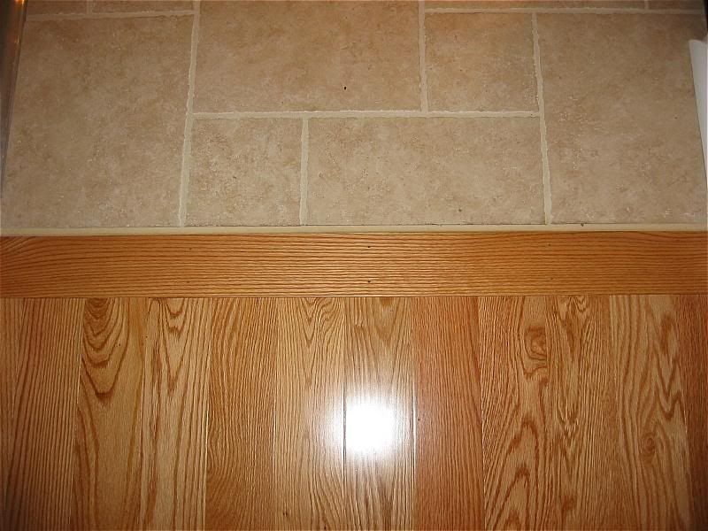 clear lines wood floor to cream-colored tiles transition - Clear Lines Wood Floor To Cream-colored Tiles Transition