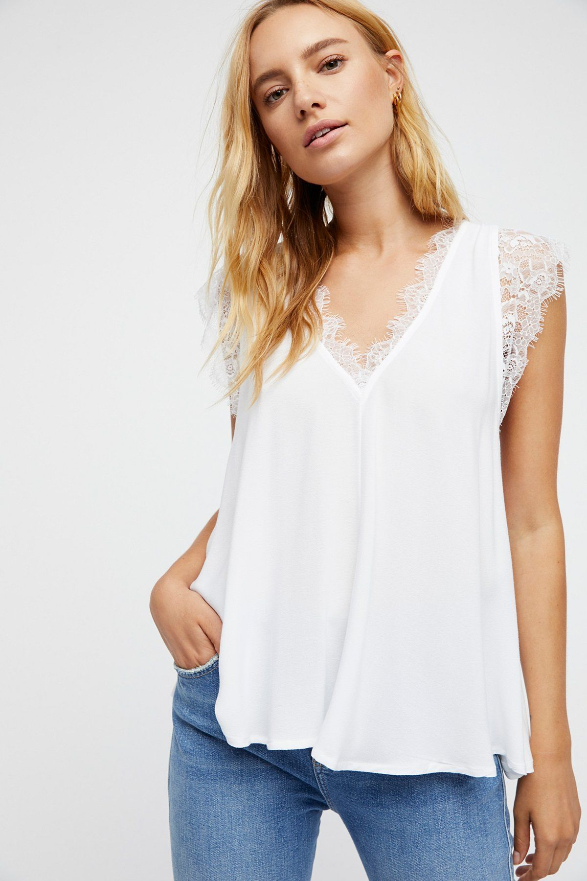 Lovin' On You Top | Femme top featuring a swingy silhouette with lace trim along the V-neckline. * Lightweight, sheer fabrication
