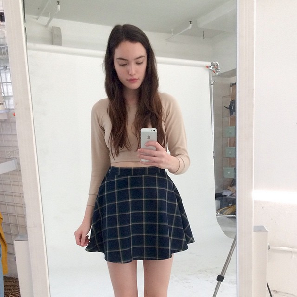 7f335e30aa2 American Apparel model Megan snaps an  AASelfie in the Plaid Circle Skirt  and Ponte Crop Raglan Sweater.
