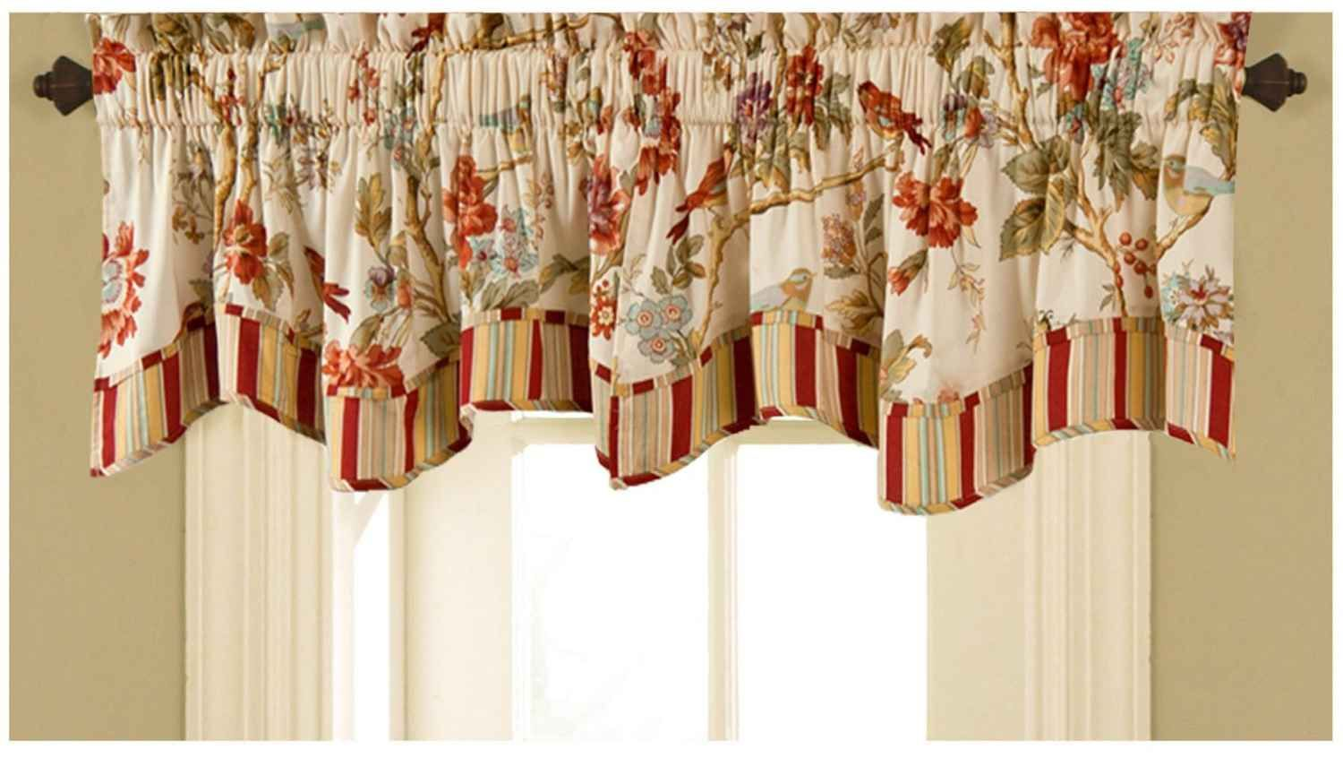 The color choice and the pattern of the kitchen valances