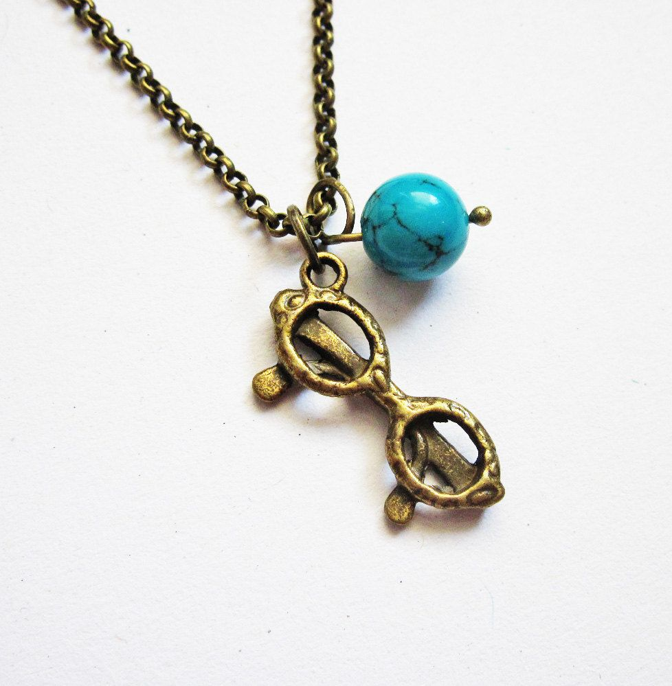 eye glasses necklace, sunglasses necklace, quirky necklace, geek jewelry, turquoise necklace, brass necklace, summer necklace, beach A lovely summer necklace featuring a 3dimensional eye glasses charm and a genuine Turquoise. I have selected this precious stone because its gorgeous blue color reminds of the sea and of the ocean, so it completes the whole idea of a marine necklace. Simple and perfect for everyday wear. - To add personalized initial to your jewelry, simply add this other item to y