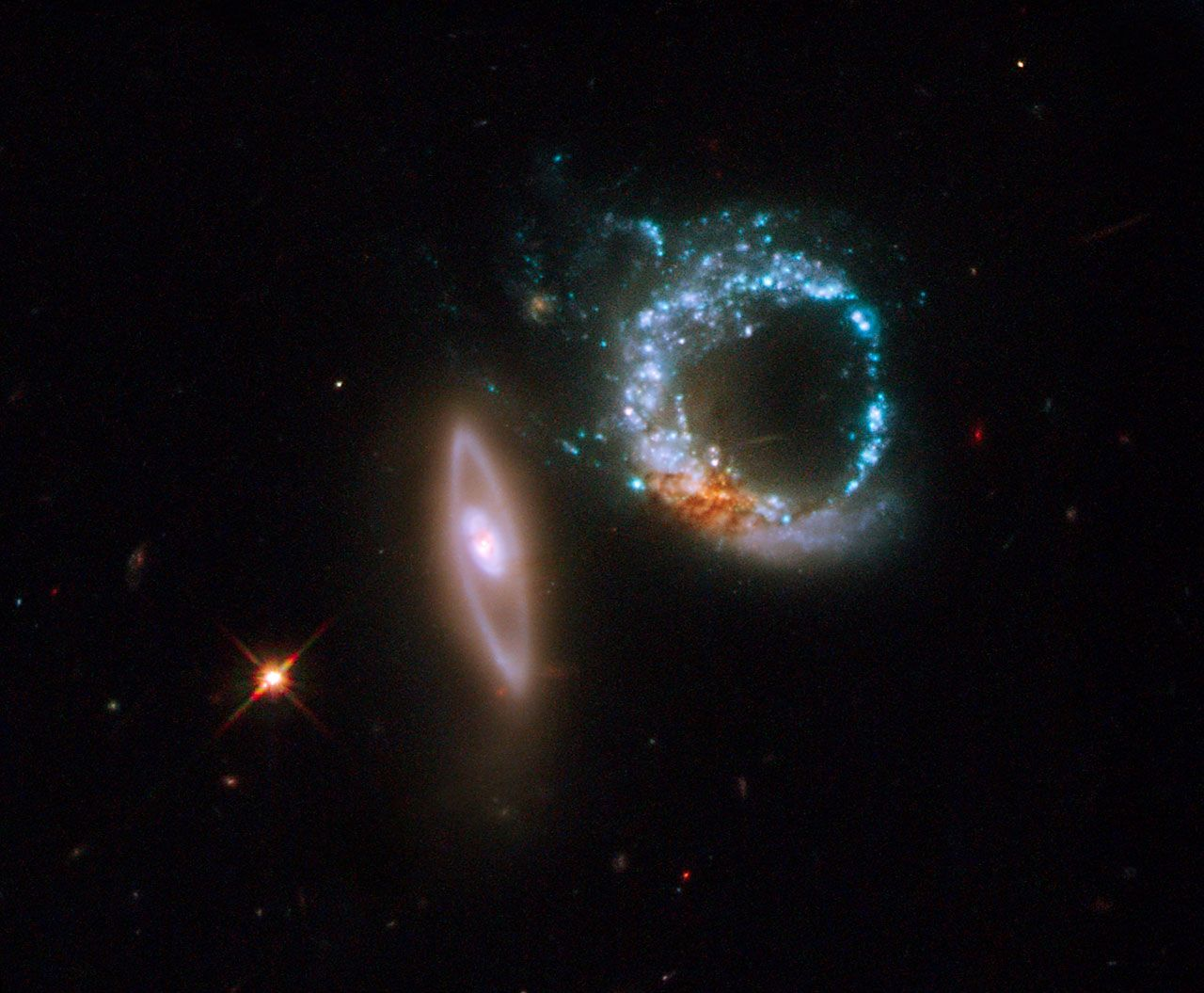 "A perfect 10 for the Hubble Space Telescope! This once-in-a-lifetime image shows a pair of gravitationally interacting galaxies called Arp 147. The galaxy on the left, or the ""one"", is relatively undisturbed, whereas the galaxy on the right, or the ""zero"", is a messy ring of intense star formation.  Image credit: NASA, ESA and M. Livio (STScI)"