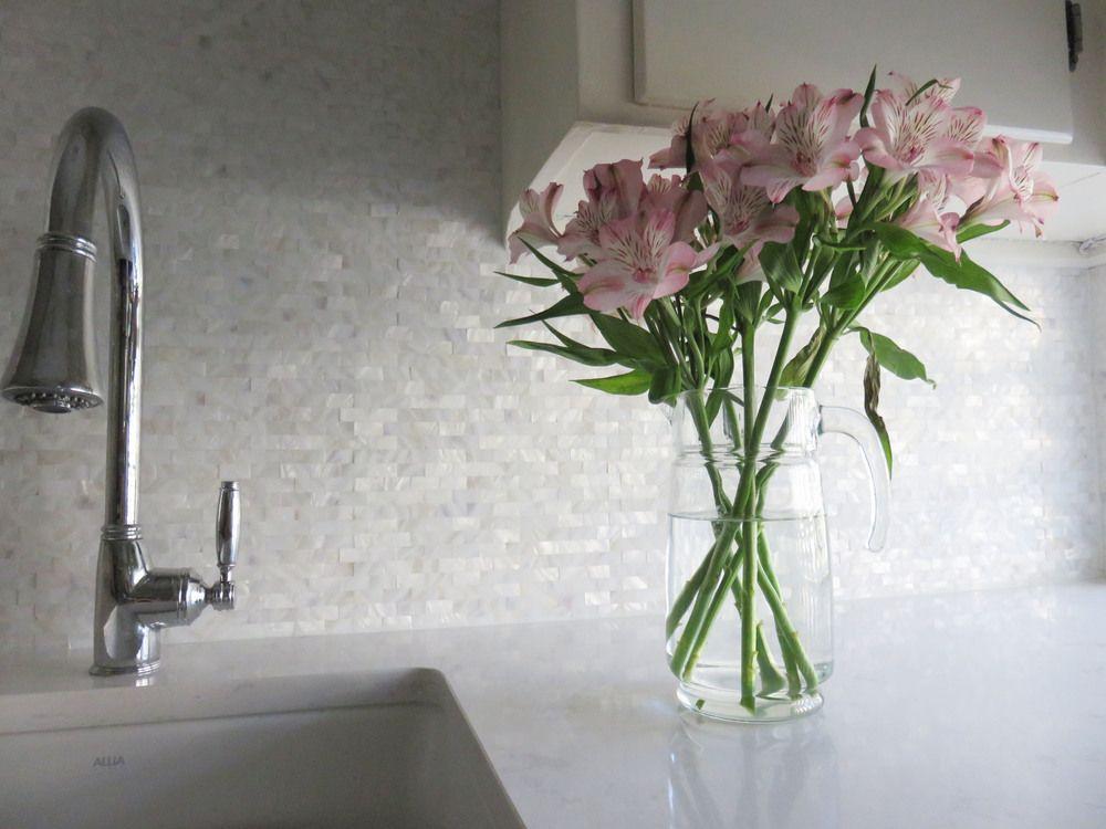 White brick groutless pearl shell tile backsplash. https://www ...