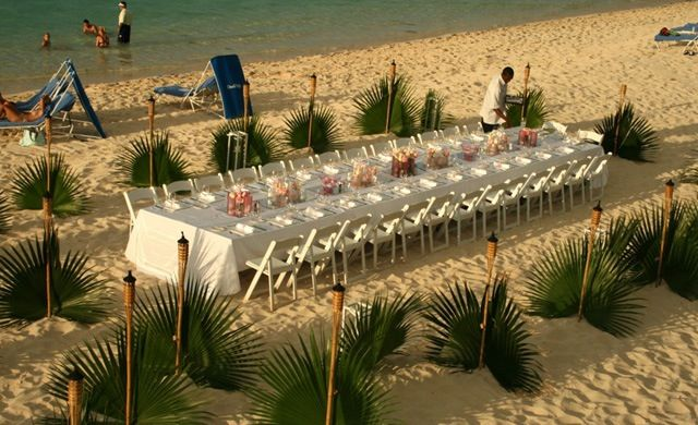 Beach event with palms and tiki torches