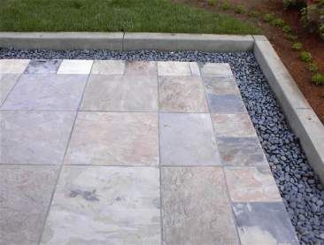 Slate Tile Patio With Mexican Pebble Border.JPG