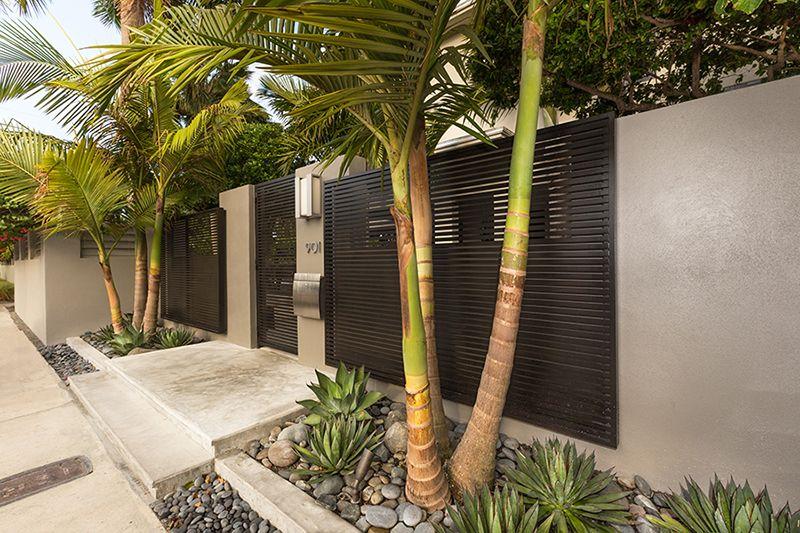 modern tropical landscape design  water feature  corten steel  landscape design  key west  entry
