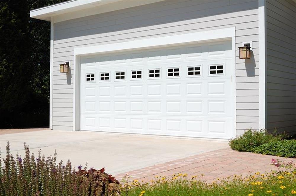@C.H.I. Overhead Doors Model 2250 Steel Raised Panel Garage Door In White  With Stockton Glass