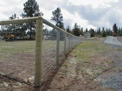 Round Post Fence With Wrapped Wire Fencing With Images Ranch