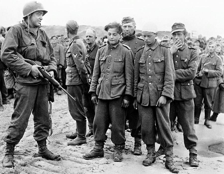An American Soldier Guards Very Young And Old German Soldiers On A Beach In Normandy June 1944 World War Two American Soldiers Wwii