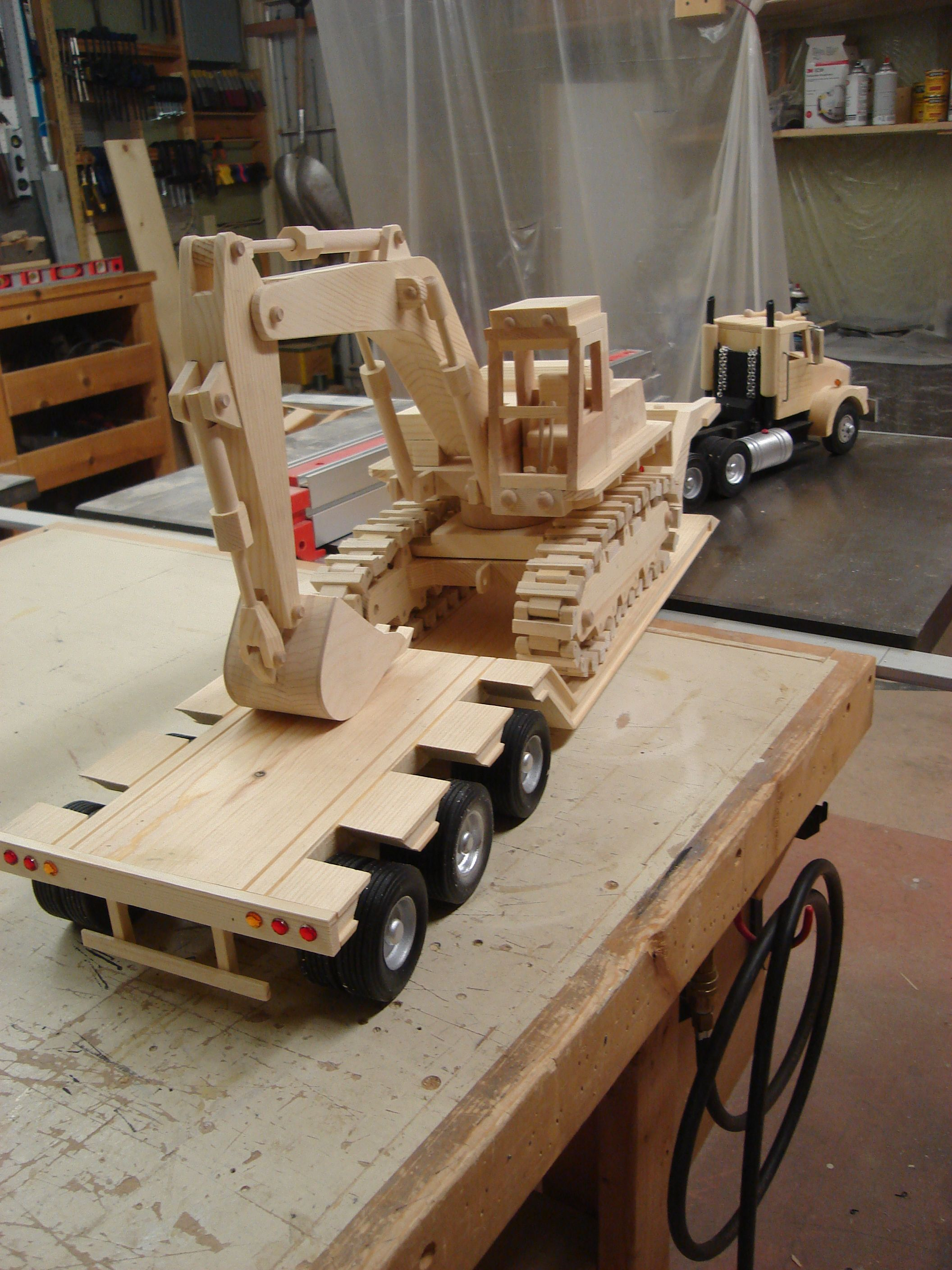 rear view of truck with excavator | wooden trucks and heavy
