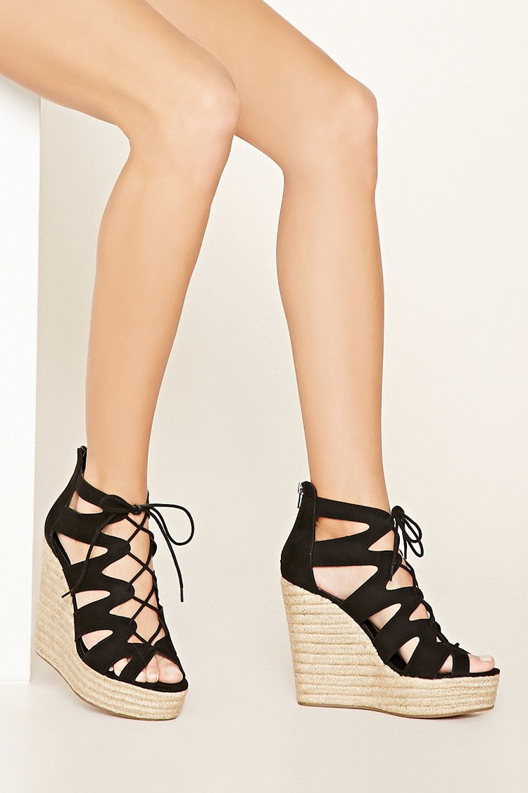 A pair of faux suede sandals complete with a cutout design, a lace-up