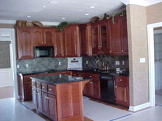 medium cherry cabinets and granite | we offer both custom built
