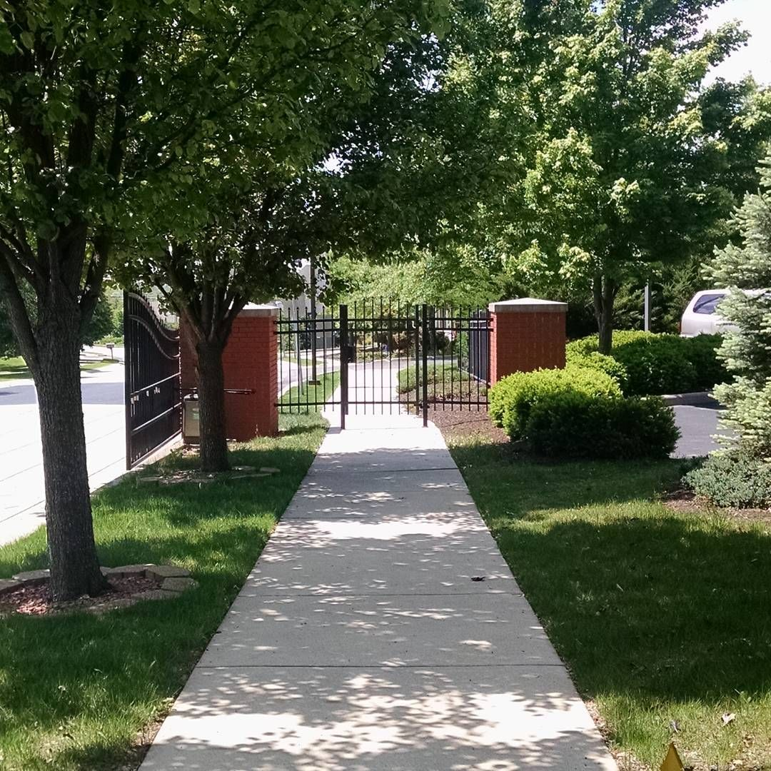 Gate To Part Of The Kennunn Lawoffice Grounds Summer