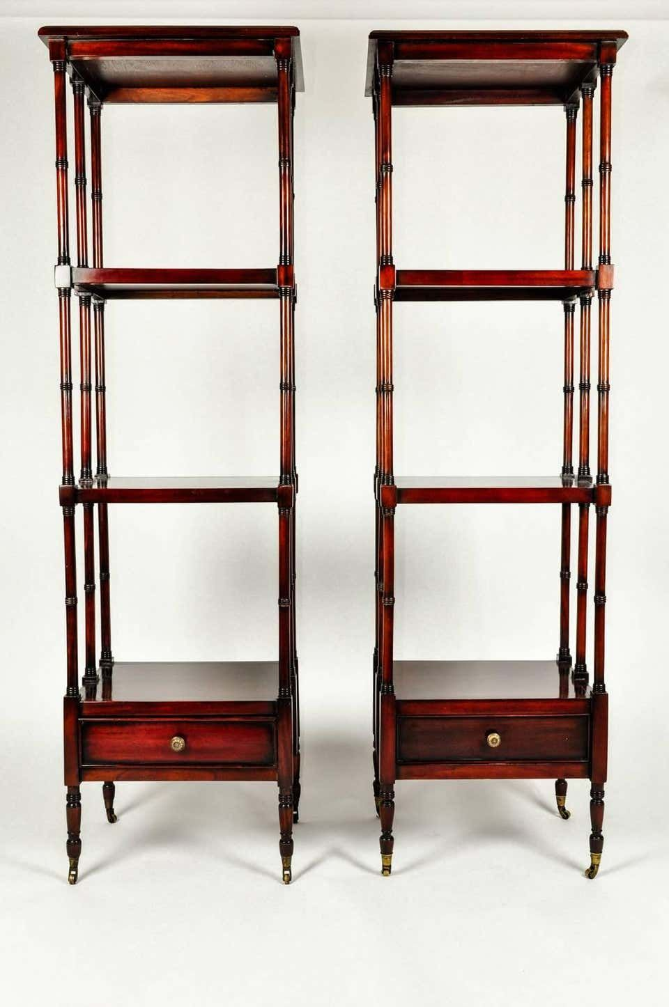 For Sale on 1stdibs - Vintage pair solid mahogany wood display shelves / etageres with lower bottom drawer. Both pieces are in excellent vintage condition. Minor wear consistent