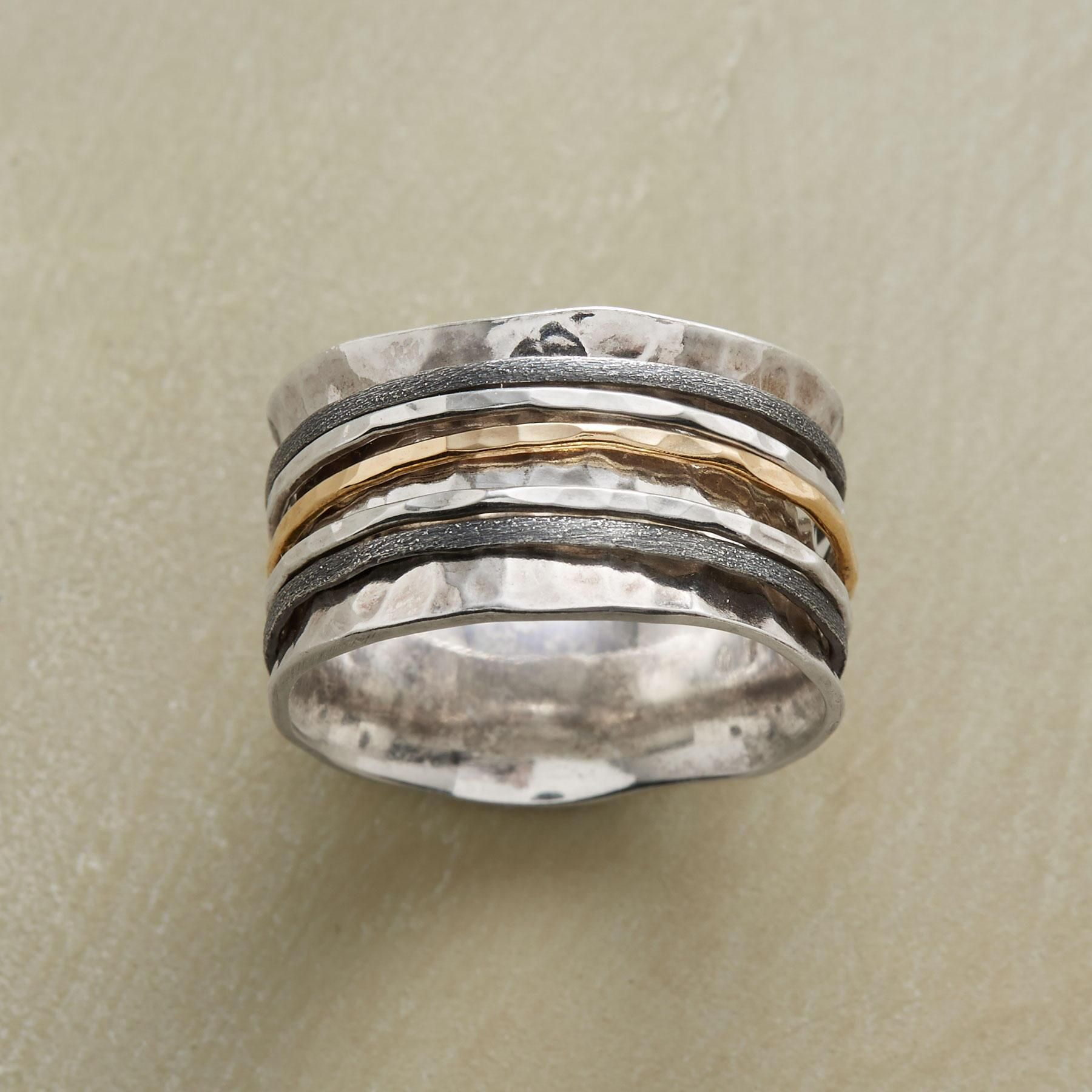 "SPOOLED SPINNER RING -- In this mixed-metal spinner ring, five slender rings of sterling silver and 14kt gold spin upon a spooled band of hand-hammered sterling silver. Whole sizes 5 to 9. 1/2""W."