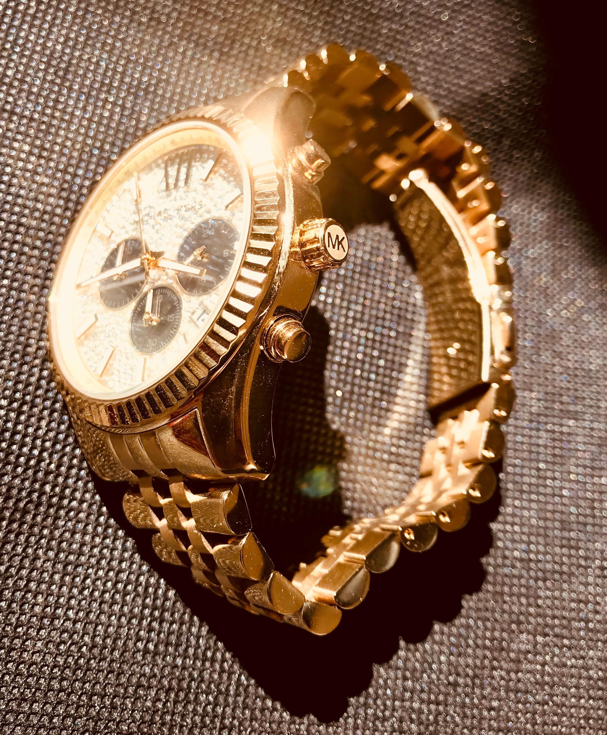 6dc4a0a6635e ... worldwide shipping Dynamic style combines with high-caliber quality to  create this gorgeous gold-tone timepiece from Michael Kors  Lexington  collection.