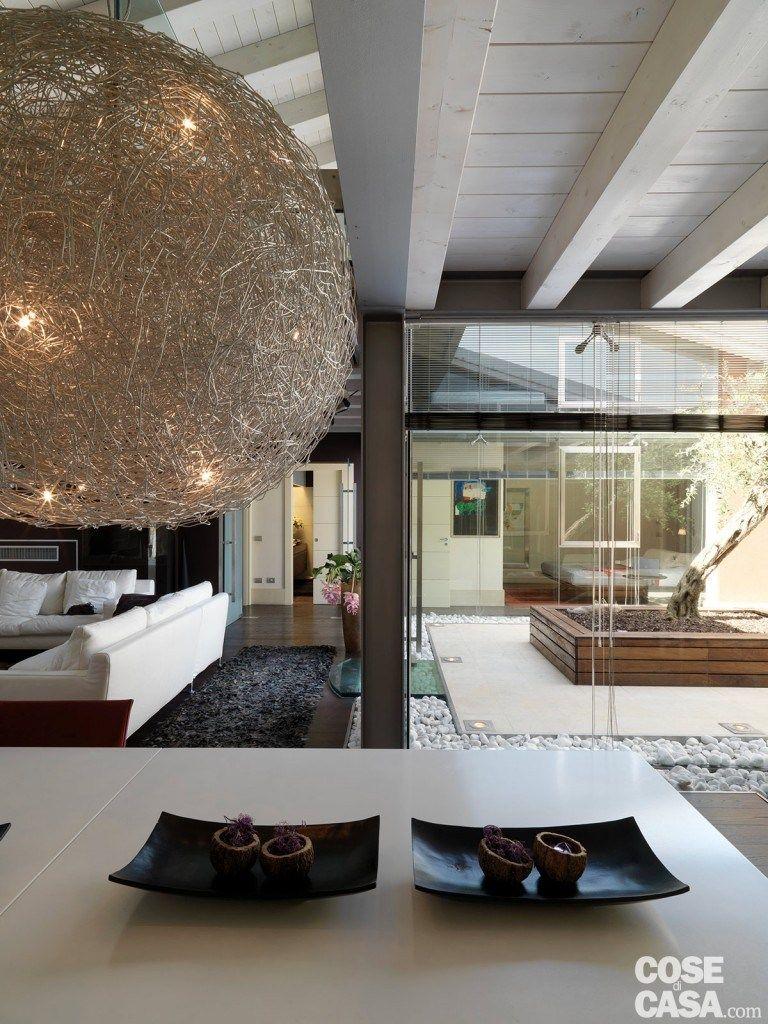 Une maison contemporaine avec patio vitré   PLANETE DECO a homes ...