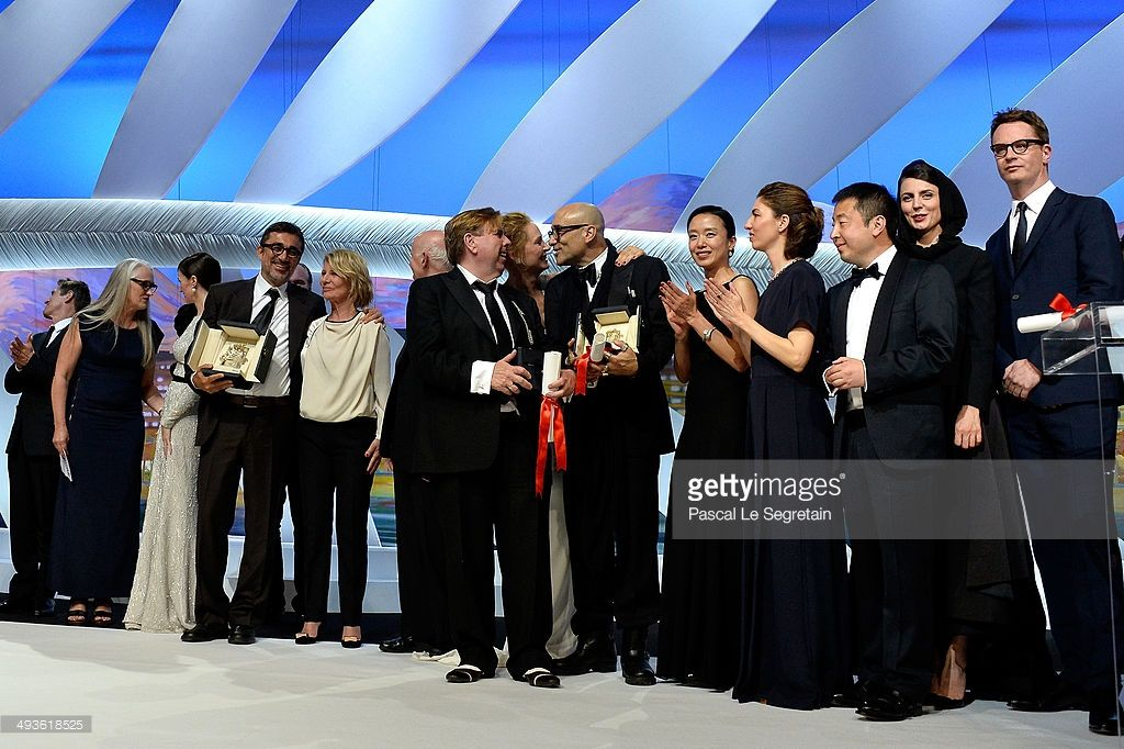 Willem Dafoe, Jane Campion, Paz Vega, Nuri Bilge Ceylan, Nicole Garcia, Gilles Jacob, Timothy Spall, Uma Thurman, Bruce Wagner, Do-yeon Jeon, Sofia Coppola, Zhangke Jia, Leila Hatami and Nicolas Winding Refn pose on stage during the Closing Ceremony at the 67th Annual Cannes Film Festival on May 24, 2014 in Cannes, France.