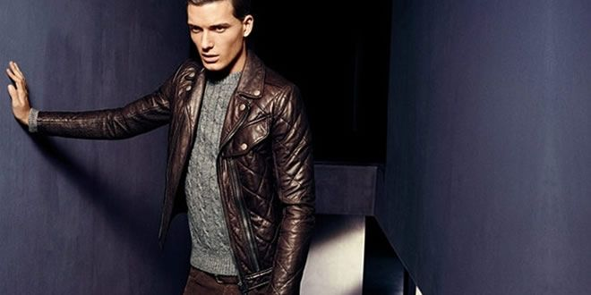 Coordinating leather jacket with knitwear.