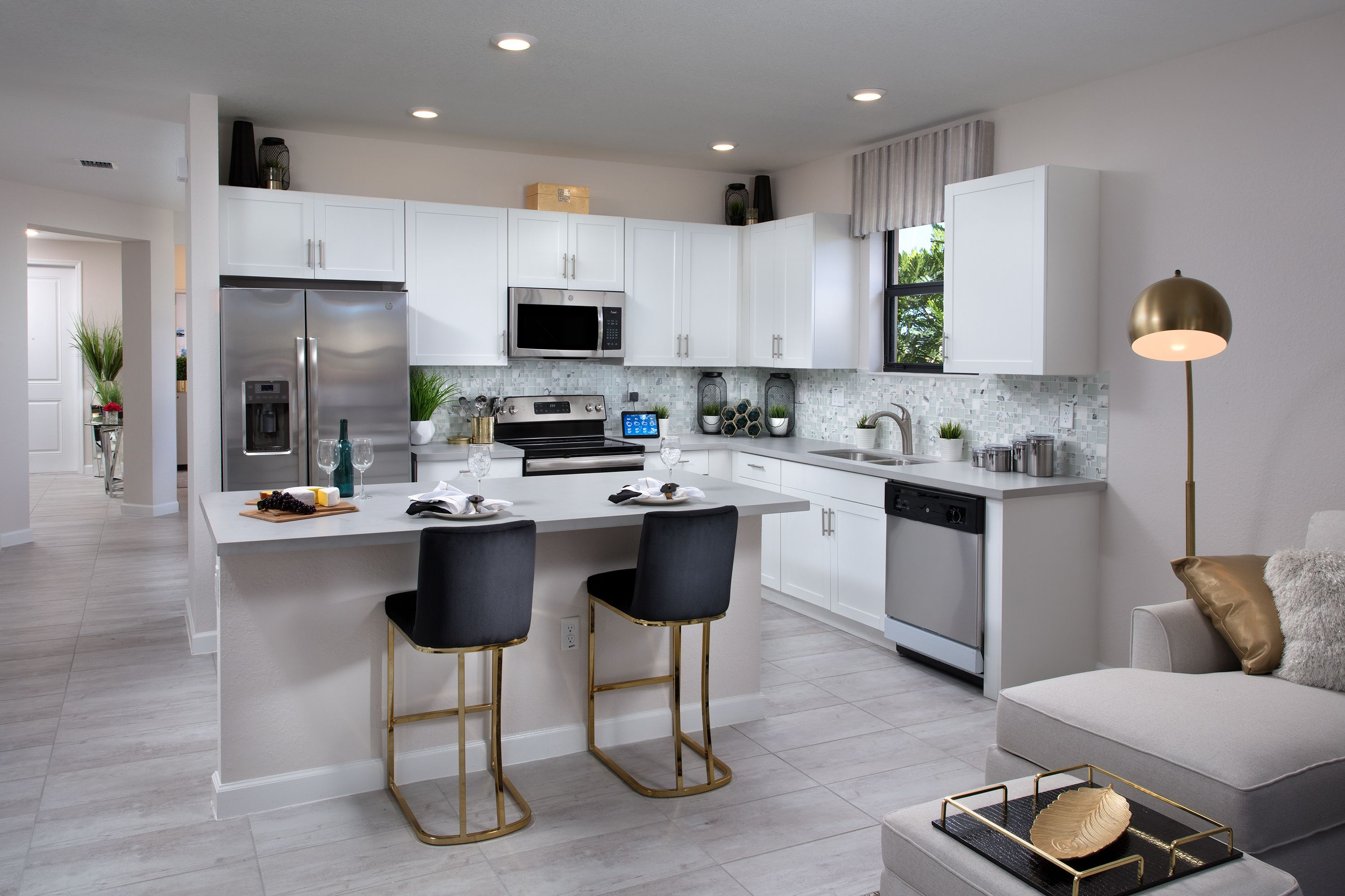 The Kitchen Features Stainless Steel Appliances Large Pantry Closet And Center Island To Make Cooking A Breeze Portovita In 2020 New Homes Home New Homes For Sale