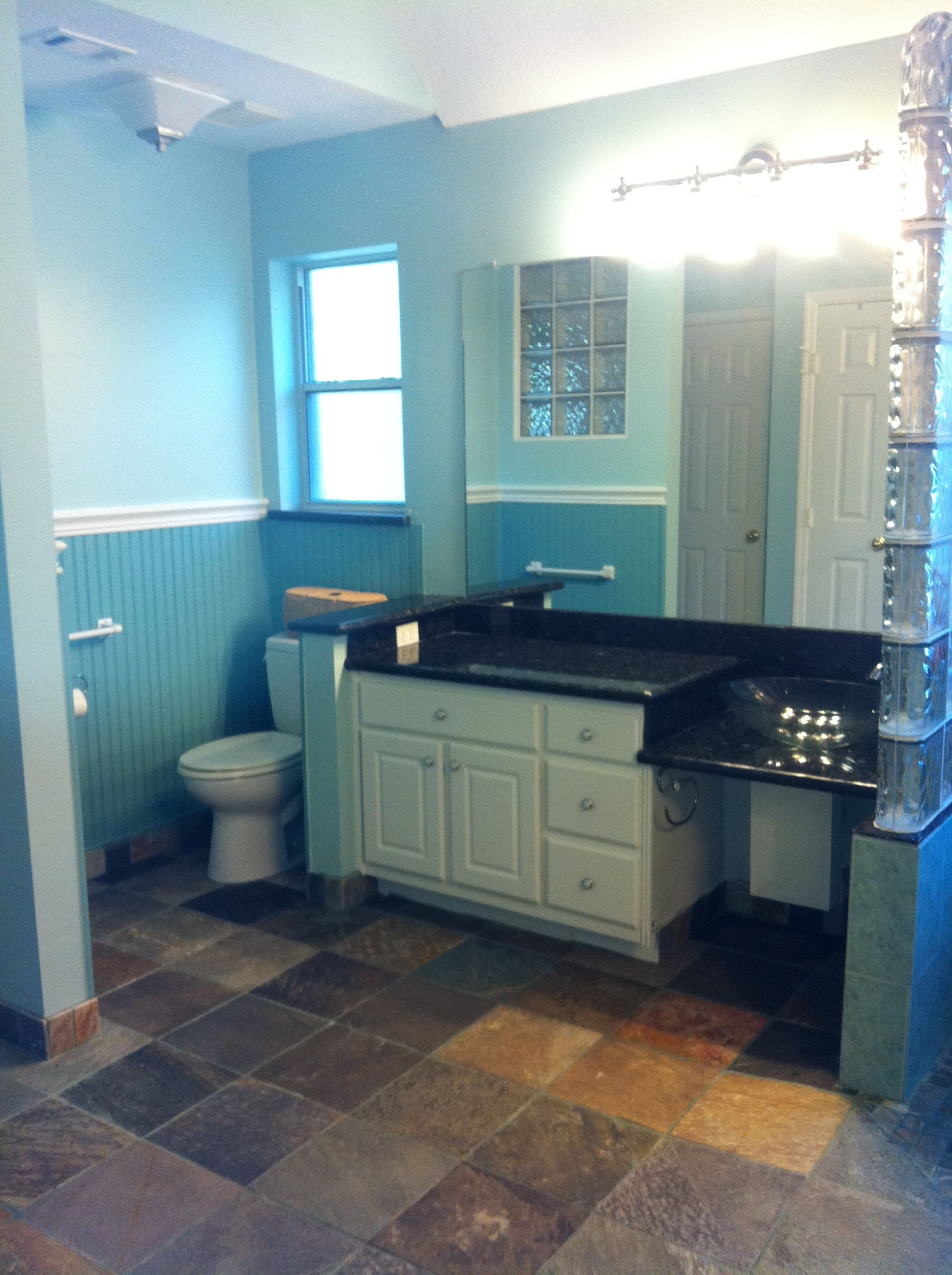 We opened the vanity base and lowered the counter to accommodate our