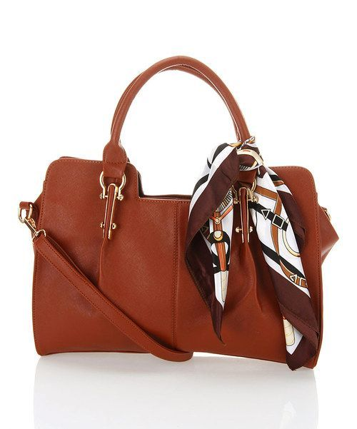 versatile, this sophisticated satchel tied off with a chic scarf will conveniently store all essentials in style. Enjoy countless carrying options with an adjustable, removable shoulder strap along with the two classic handles up top. Three interior pockets, including two media pouch...