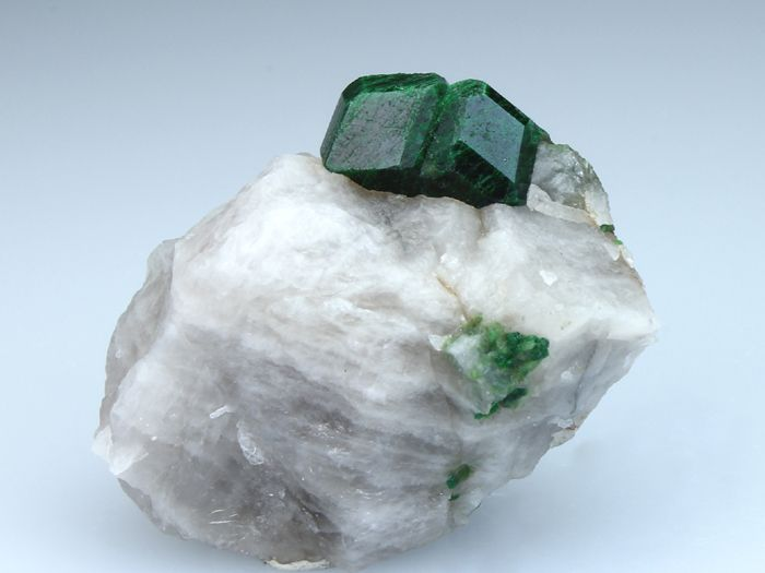 2 well-formed crystals of UVAROVITE GARNET on white Quartz matrix. From Outokumpu, Ita-Suomen Laani, Finland, Europe. It's so rare to see such large Uvarovite crystals.