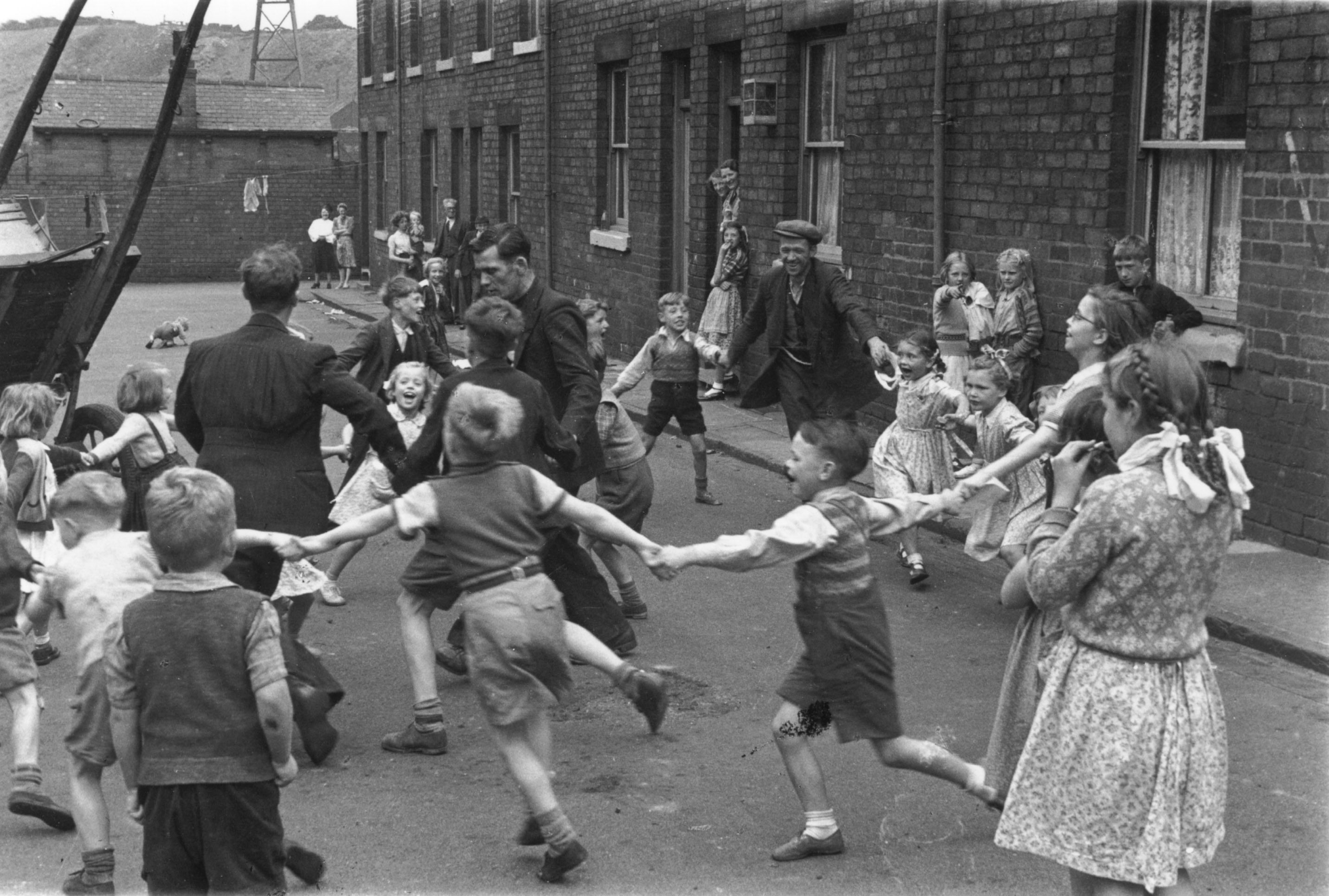 Miners playing with their children in Fryston, Yorkshire (1940s)