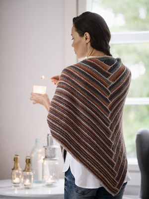 FREE PATTERN! Novita 7 Veljestä Raita (7 Brothers Stripe) and 7 Veljestä (7 Brothers) yarns alternate in this pretty shawl worked flat. BUY YARN AT:https://www.stickitup.nu/en/