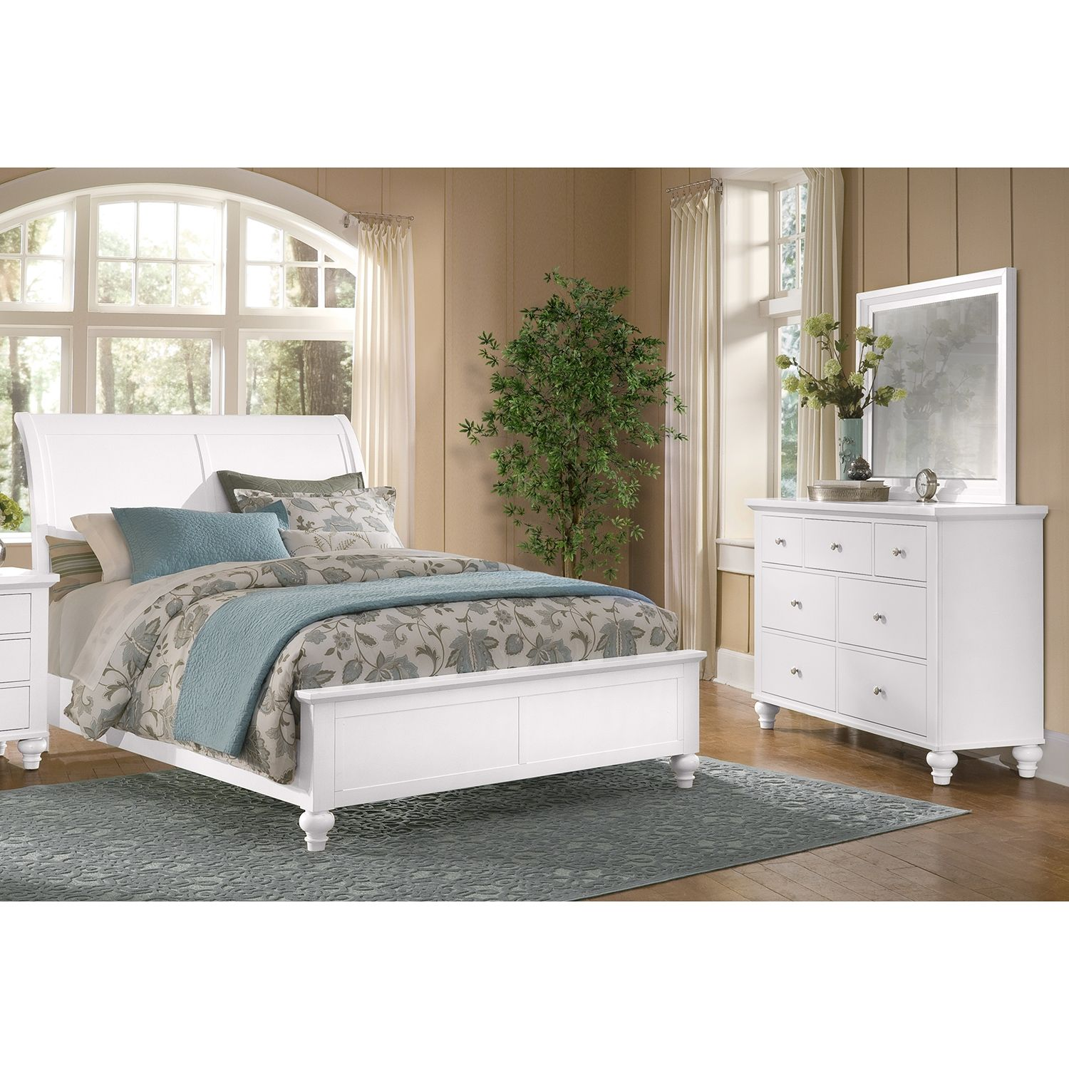 Charmed, Im Sure. Our Savannah White collection embraces all the airiness of a coastal escape, while keeping traditional design sensibilities in mind. The crisp linen white finish defines the soothing look, breathing fresh life into any décor. The sleigh-like headboard stands tall, nicely contrasting the modest stance of the footboard. The dresser has enduringly simple charm, with flat-front drawers, turned feet and chrome knobs. Five piece package includes complete King bed, dresser and…