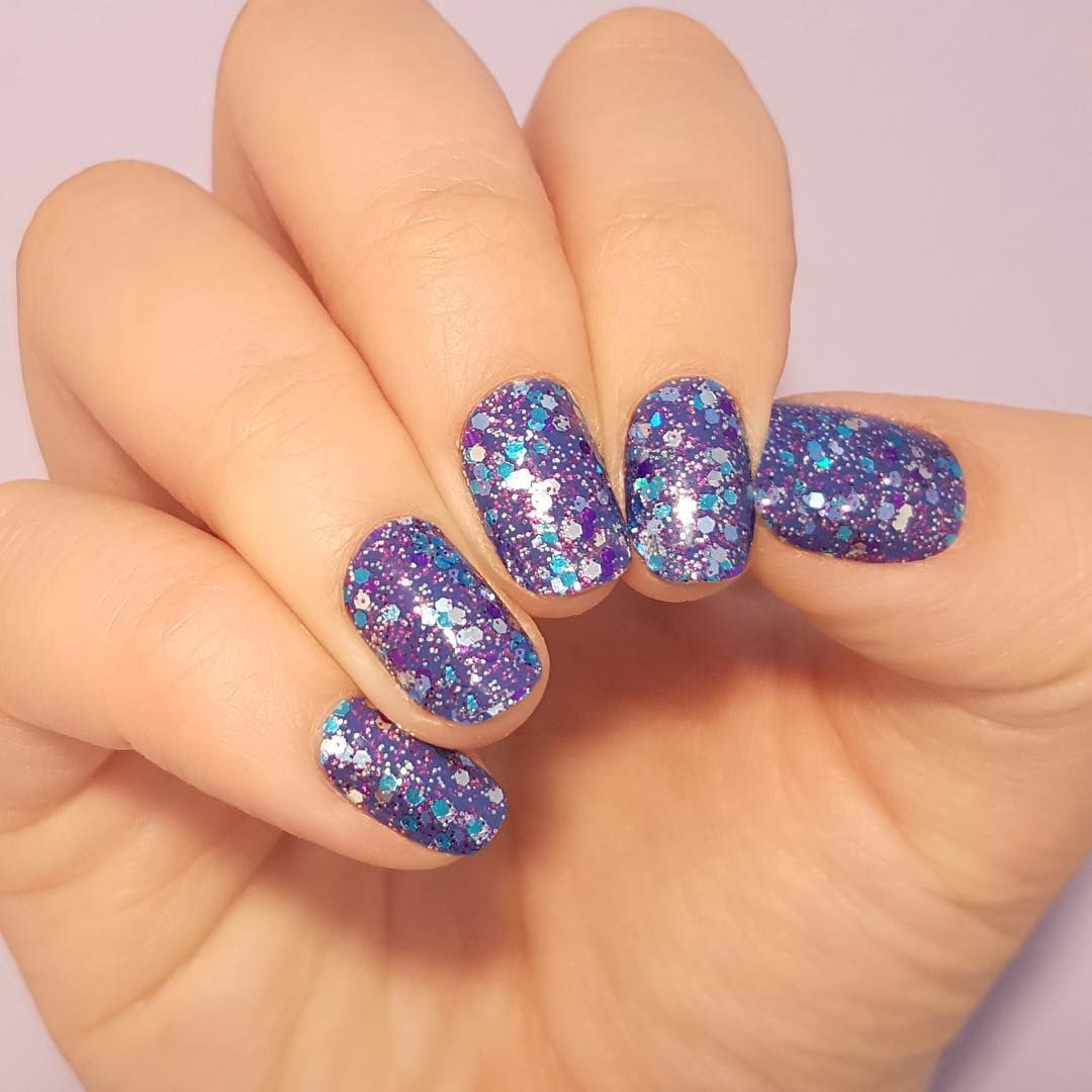 What\'s purple and blue, and sparkly all over? \