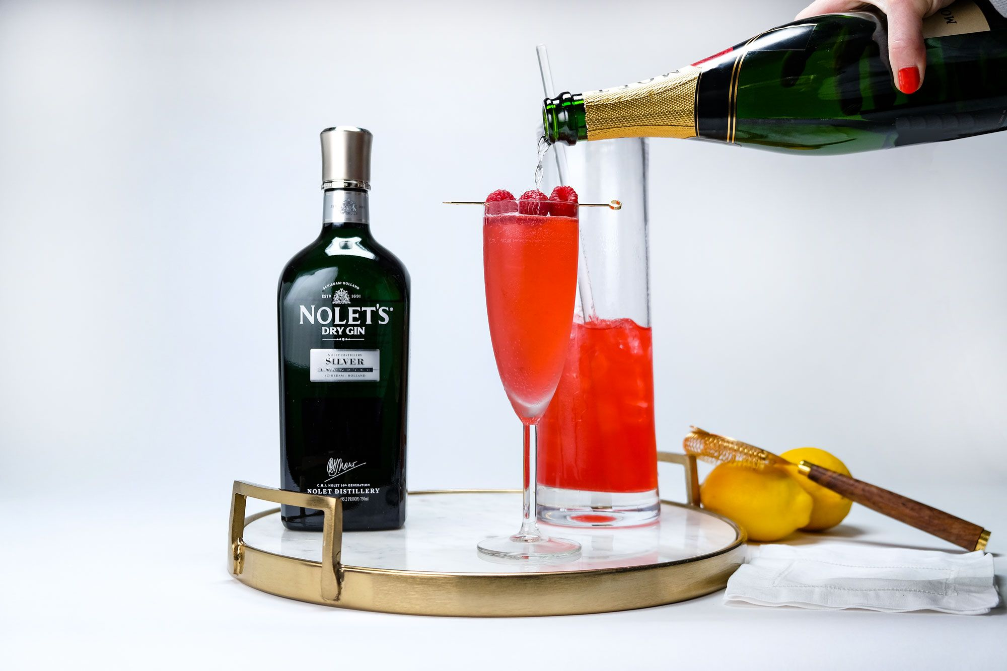 Nolet S Silver Raspberry French 75 In 2020 Raspberry Cocktail Maker Raspberry Syrup