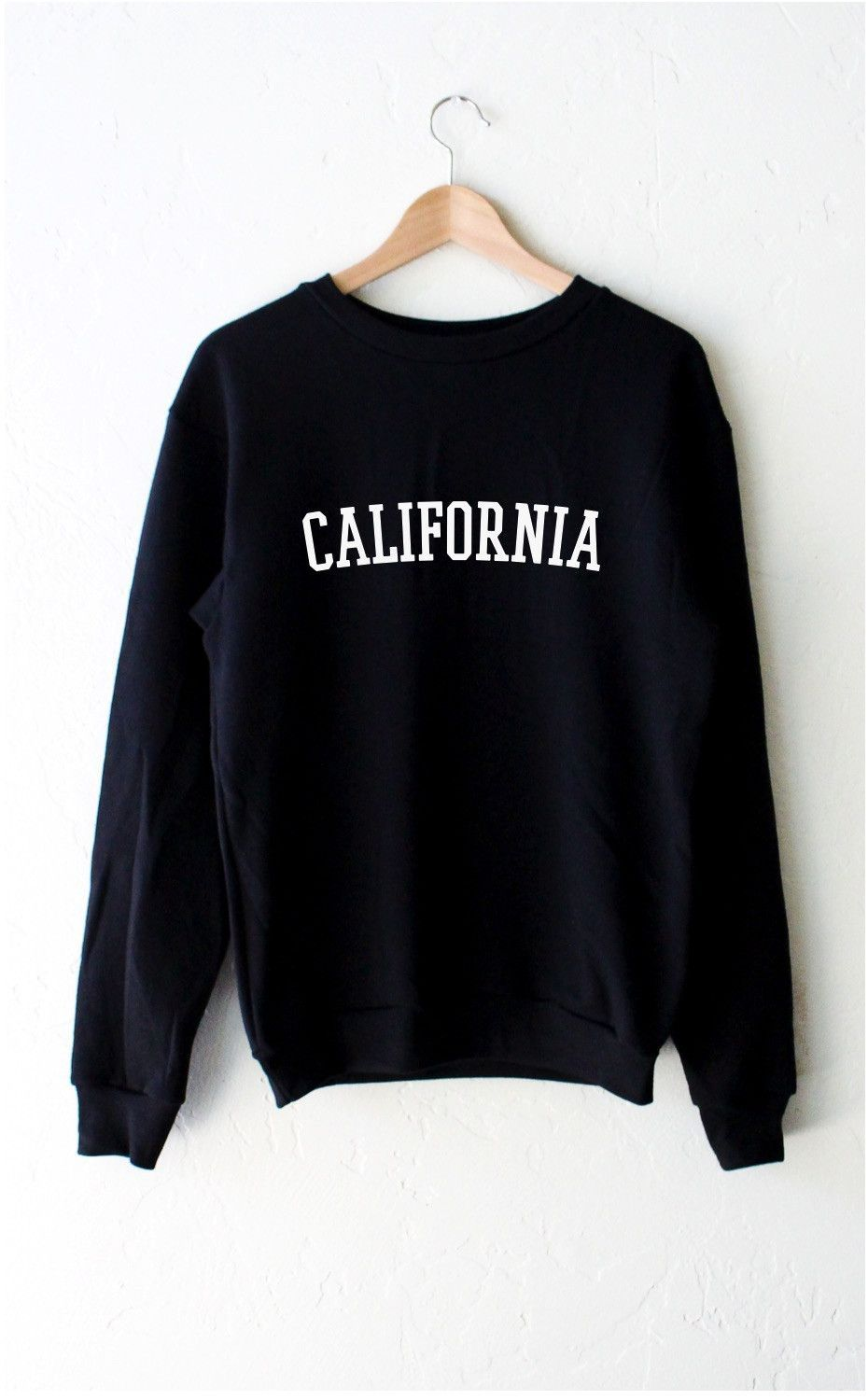 639f33543 Description - Size Guide Details: Oversized, unisex fit crew neck fleece  sweatshirt in black with print featuring 'California' by NYCT clothing.