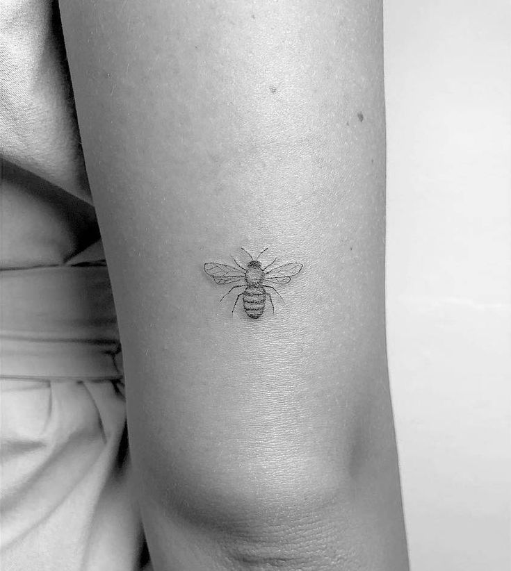 Honey bee tattoo on the back of the right arm.