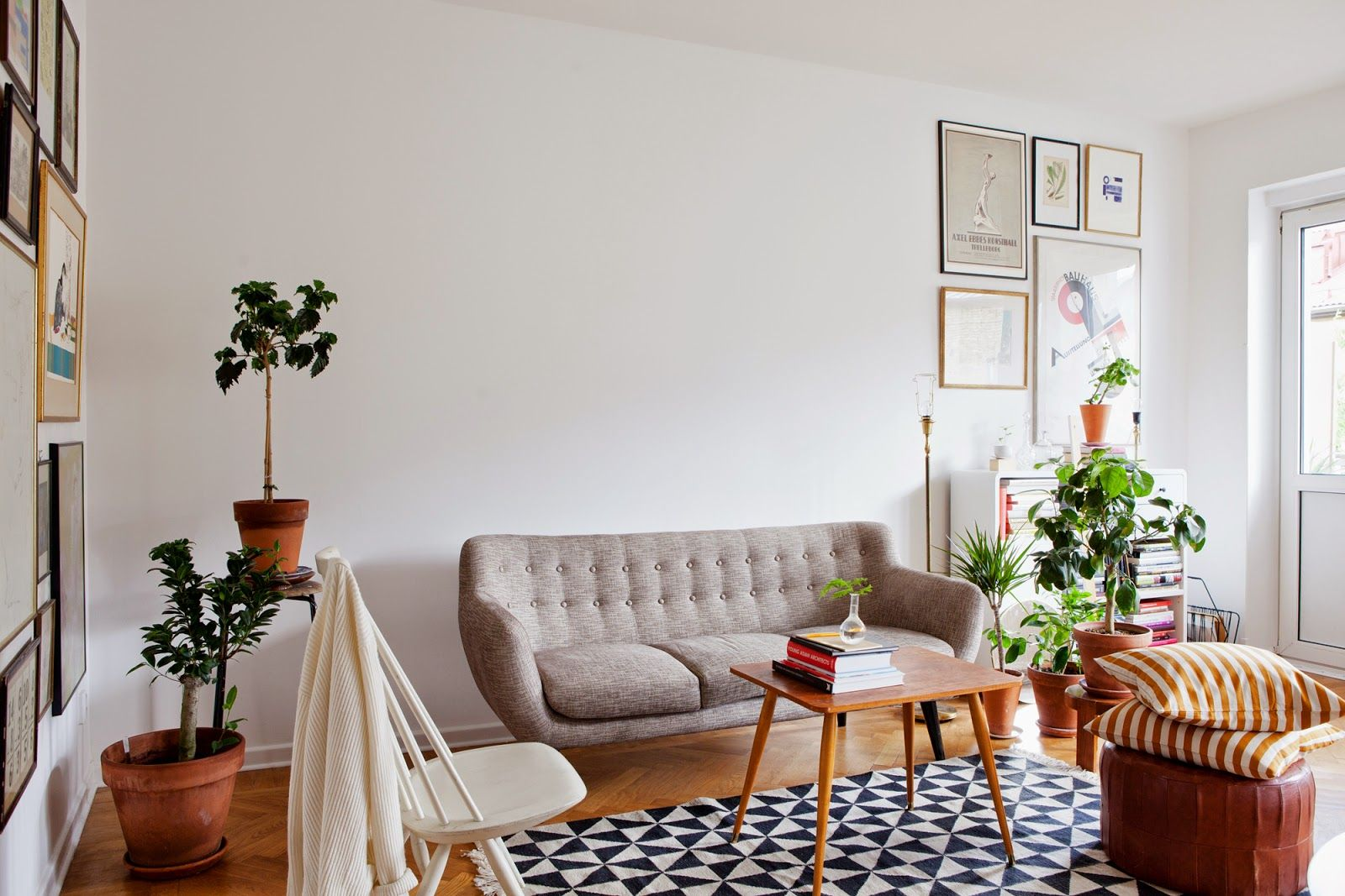 Plants And Vintage Furniture In The Living Room. Nice Sofa And Picture  Wall(s)