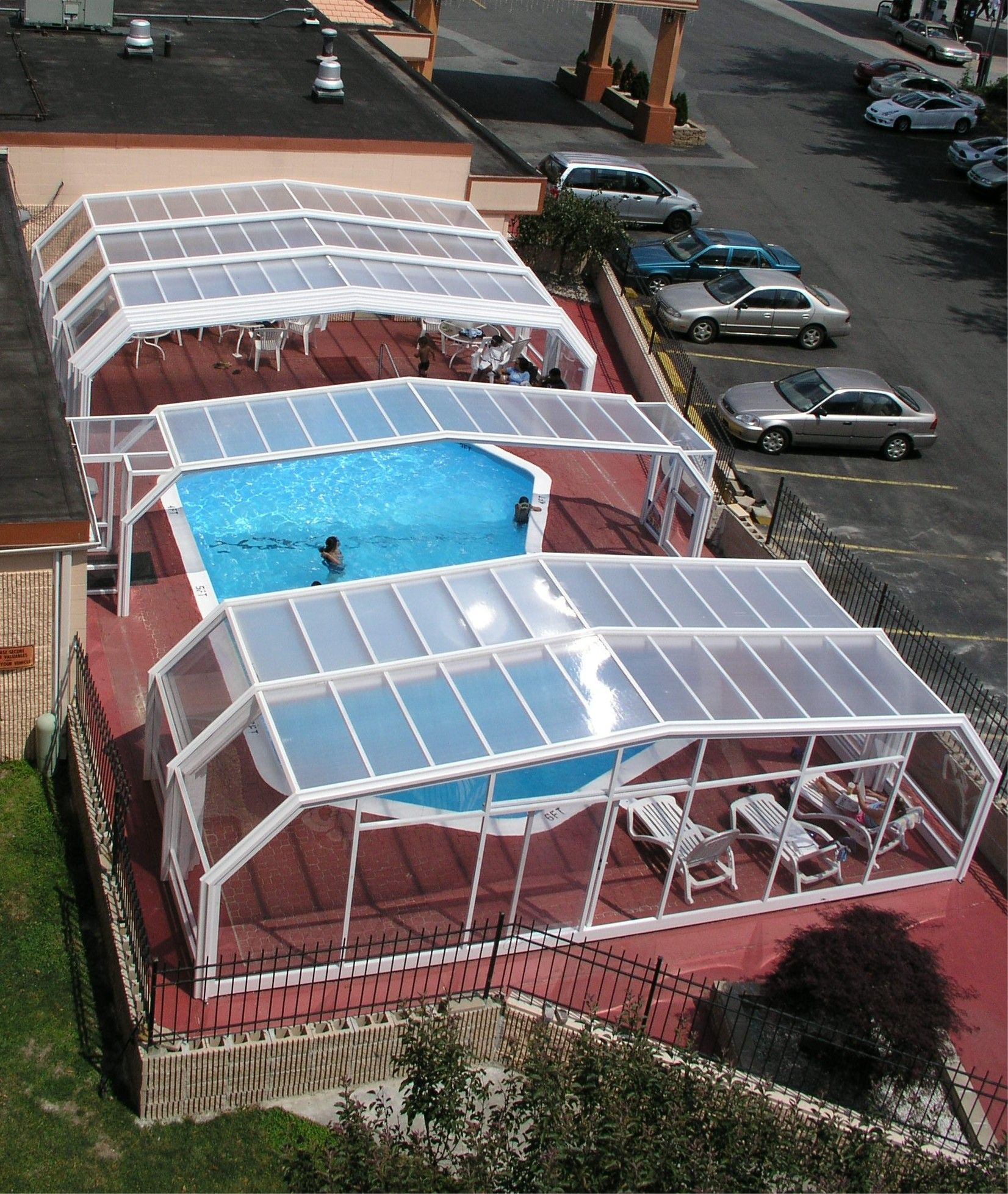 Retractable Roof Manufactured By Roll A Cover Intl Pool Enclosures Swimming Pool Enclosures Indoor Outdoor Pool