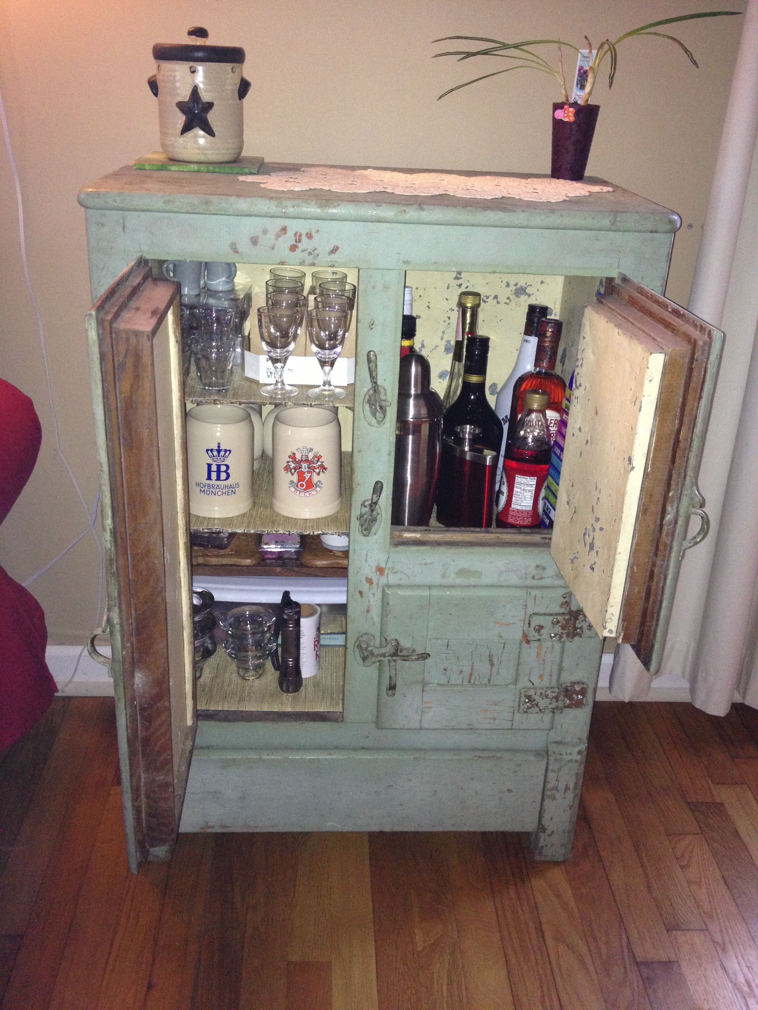 My mini bar at home! Got the antique ice box at a garage sale ...