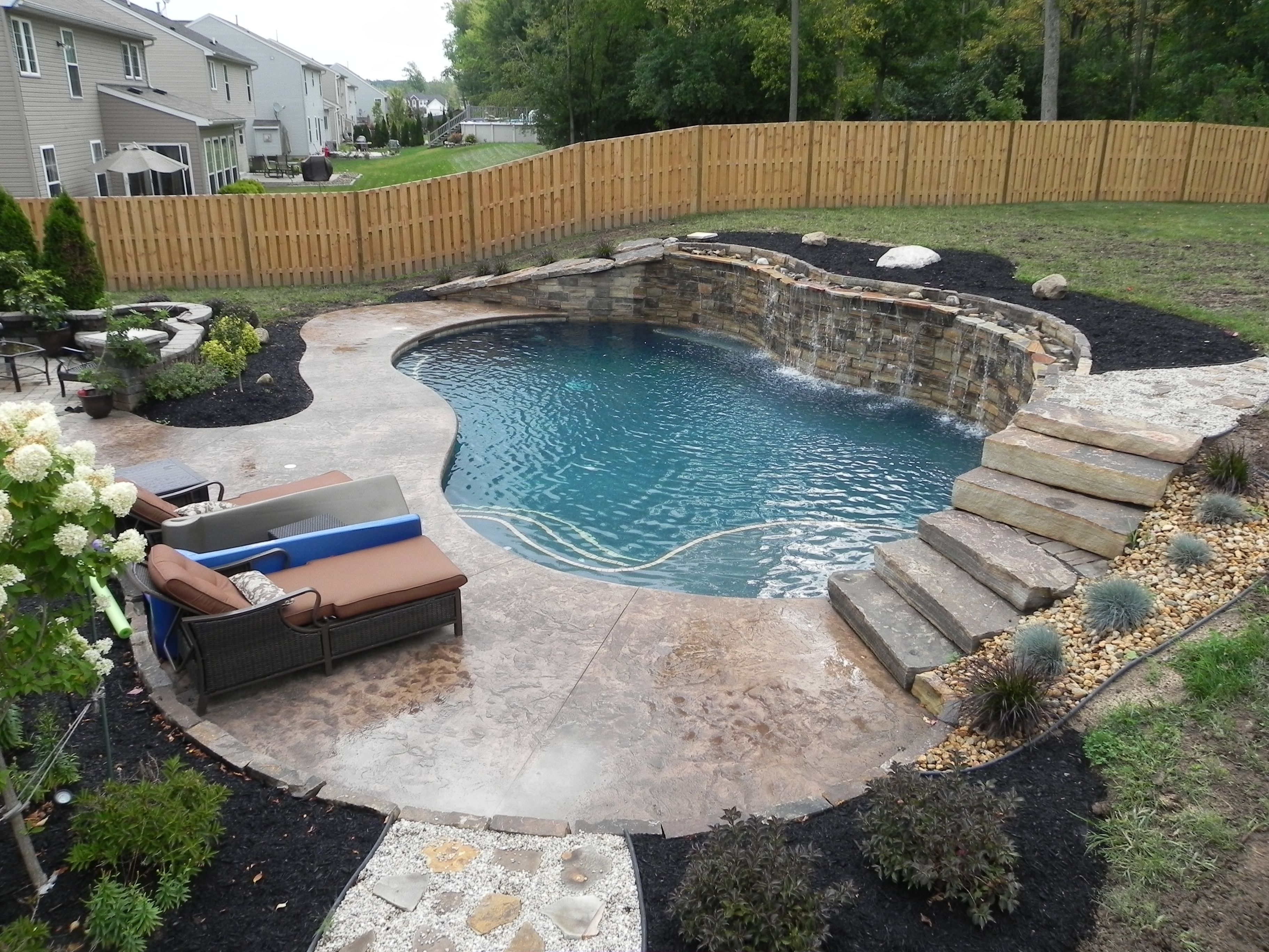 18x34 Freeform Gunite Swimming Pool With Raised Wall Waterfalls Building A Pool Affordable Swimming Pools Small Inground Pool