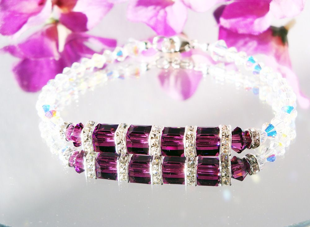 Amethyst Crystal Bracelet created with Swarovski Amethyst Purple and Aurora Borealis Crystals. ~Created to bring Love and Light to you with Sparkling Crystal Energy~ Amethyst Crystals symbolize the energy of Dreams, Imagination and Magic. Clear Crystals symbolize the energy of Kindness and New Beginnings.