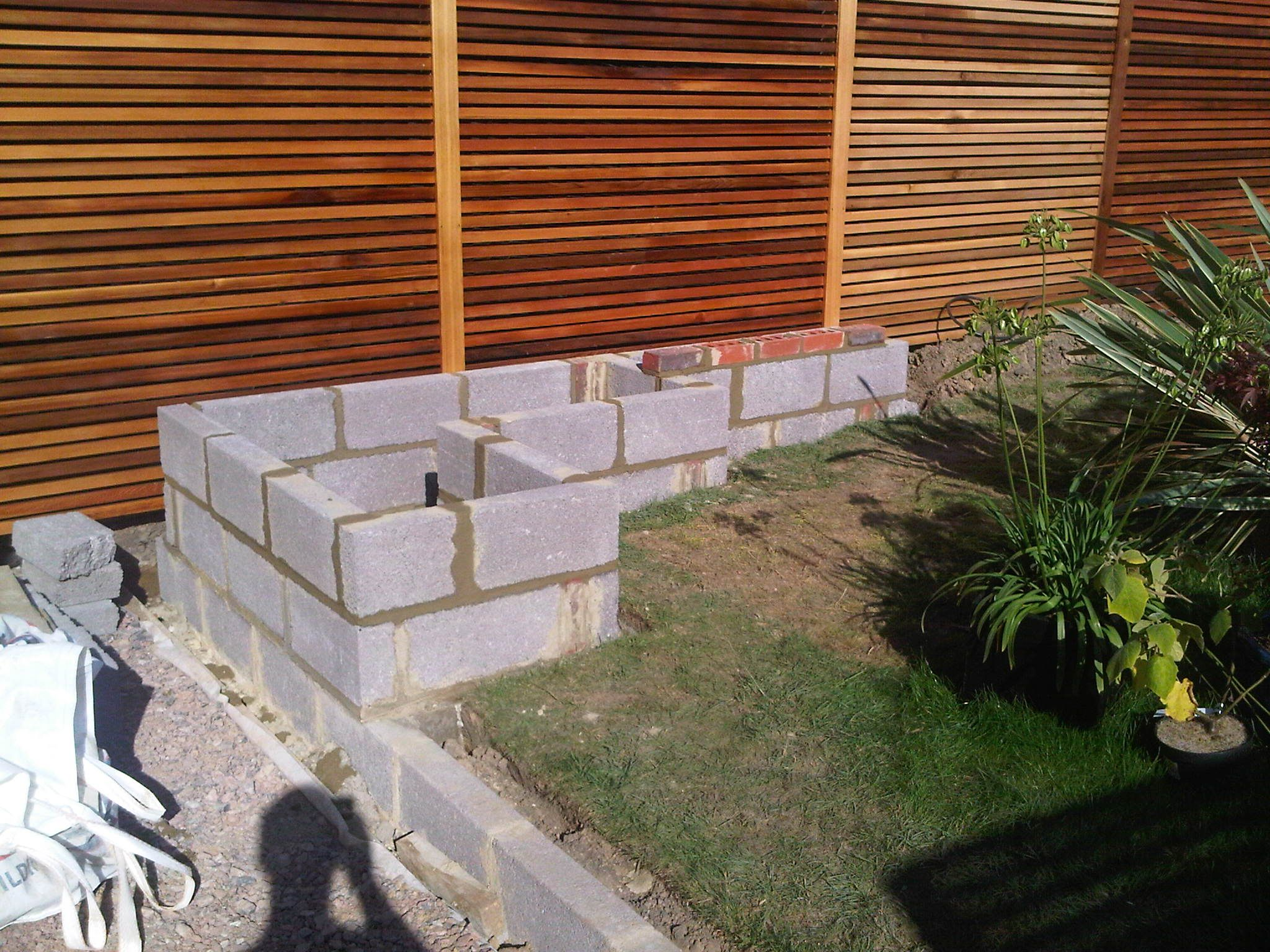 Concrete garden wall google search landscape for Designs for brick garden walls
