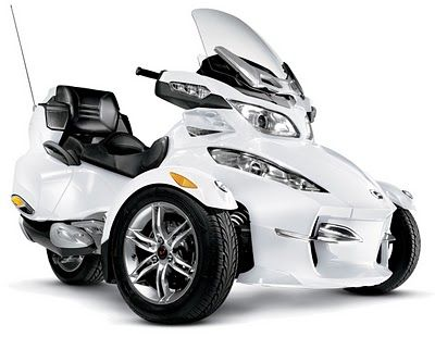 2011 Can-Am Spyder RT.  I SO WANT this!  Can't decide between this and a 2nd car.  Staying away from both dealerships for now!!!!!