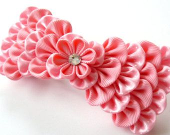 A flower is made in the technique of tsumami kanzashi. Flower is made from grosgrain ribbons. Swarovski crystal. Mounted on a large 3 1/2 inch ( 95 mm)