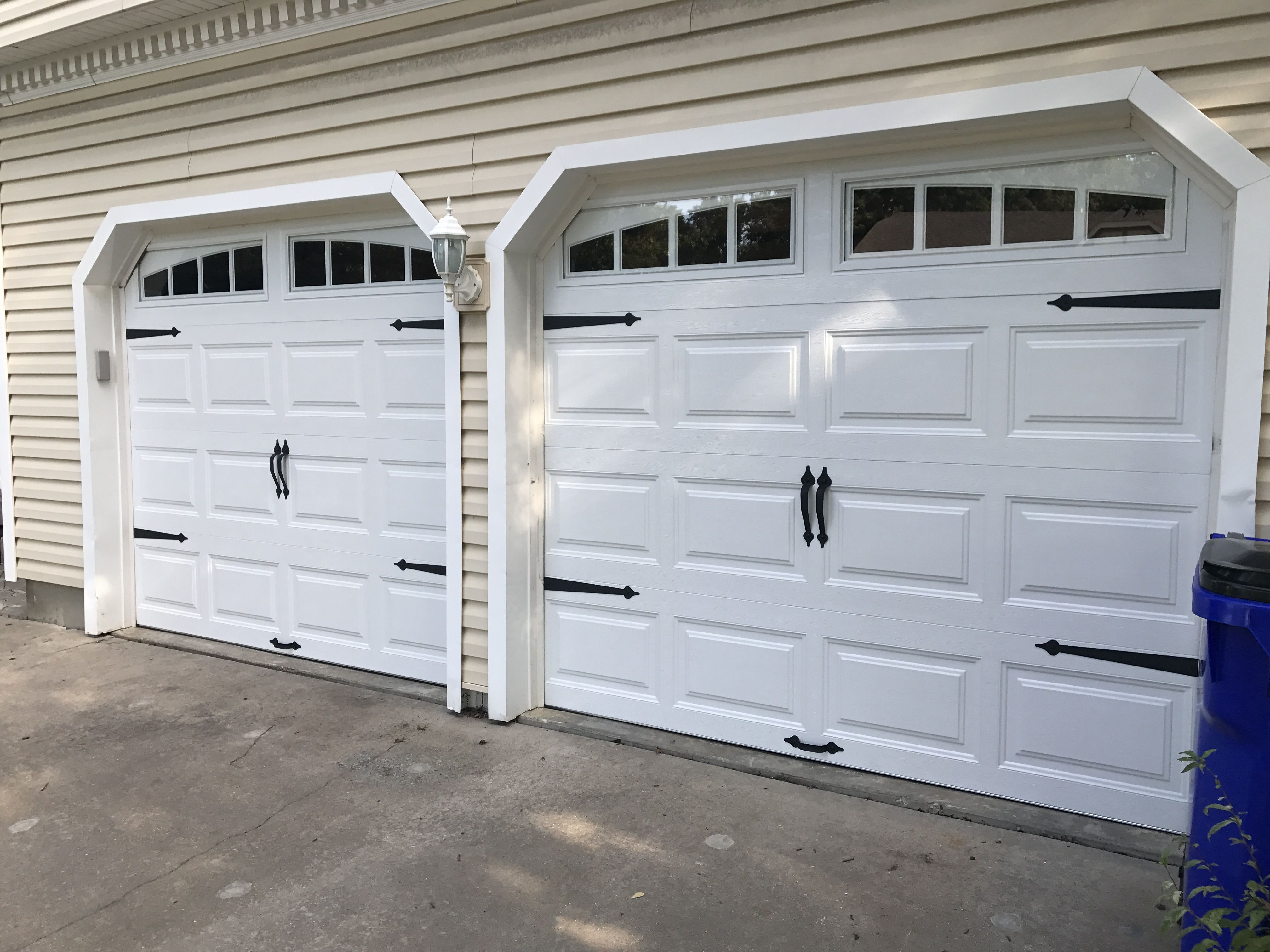 White Short Panel Garage Door With Arched Thames Windows And Decorative Handles And Straps Teamtay Garage Doors Garage Door Repair Service Garage Door Panels