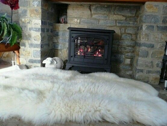 Sheepskin Rug In Front Of The Fireplace Großer