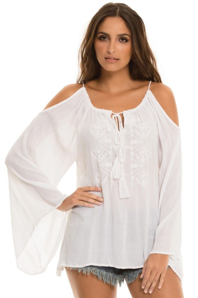 512aaea9826b1 White Embroidered Blouse -  White  peek-a-boo  shoulders embroidered blouse  with ties at neck.