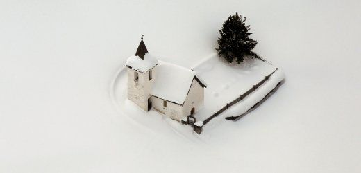 a church in the swiss village of jenisberg lies covered in snow in this aerial shot from jan. 23, 2012.