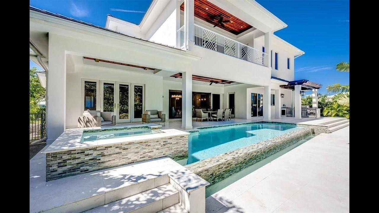 Coastal Contemporary Home In Naples Florida Sotheby S International Realty Coastal Bedrooms Coastal Interiors Coastal Cottage Bedroom