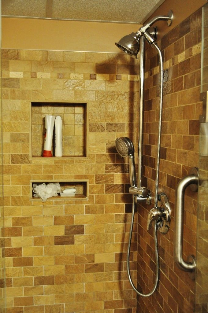 tiled shower with built in shelves so they arent taking up ...