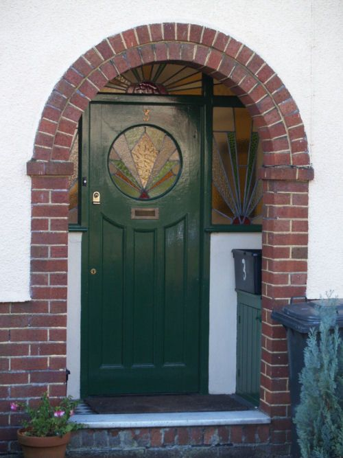 Front door with stained glass unpainted brick arch from for Exterior door with round window